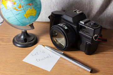Let s travel,Old camera with globe and stationary