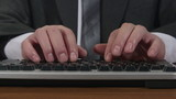 Business man typing on keyboard time-lapse