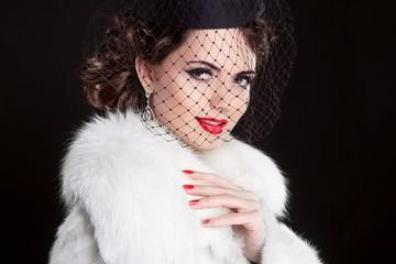 Fashion Portrait of elegant retro woman wearing little hat with
