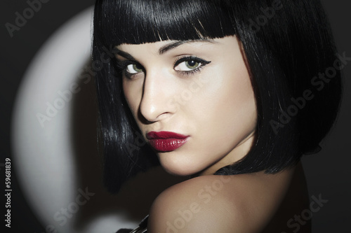 Beautiful Brunette Woman. Retro style.Black Hair. red lips