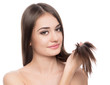 Young brunette showing her perfect healthy hair, isolated