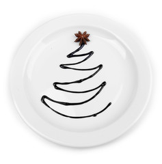 Christmas tree from chocolate on plate isolated on white
