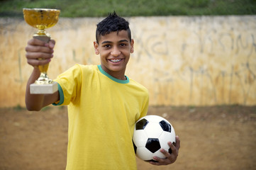 Young Brazilian Football Soccer Player Holding Trophy