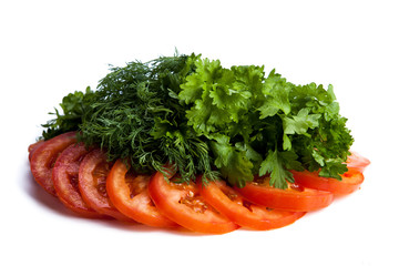 cut pieces of tomatoes and dill and parsley