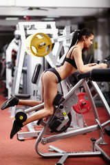 Sexy brunette working her bottom at the gym