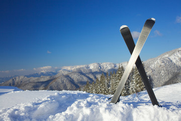 Skis in mountains