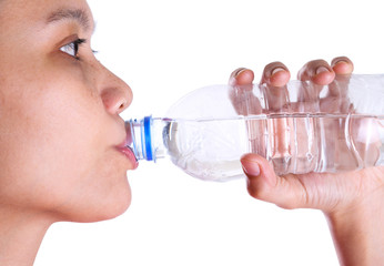Female drinking mineral water over white background