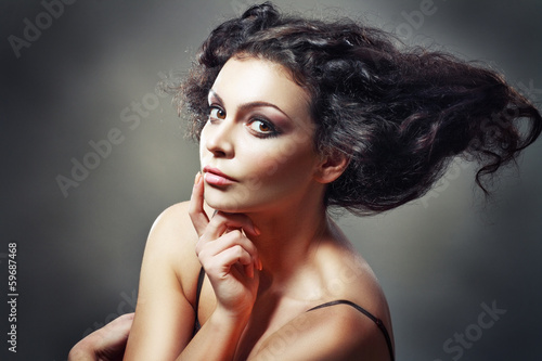 beautiful young female model with a wicked hairstyle