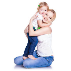 closeup portrait of young mother hug her little daughter