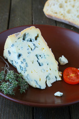 piece of blue cheese on a plate