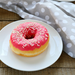 round donut with pink icing