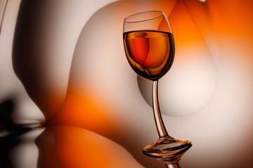 Glass of wine on abstract background