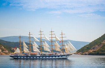 Big sailing ship goes on the water of Kotor Bay