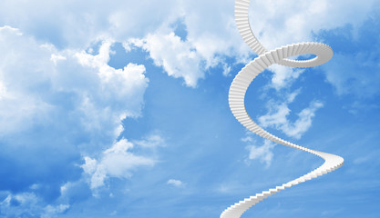 White spiral stairs goes up in blue cloudy sky