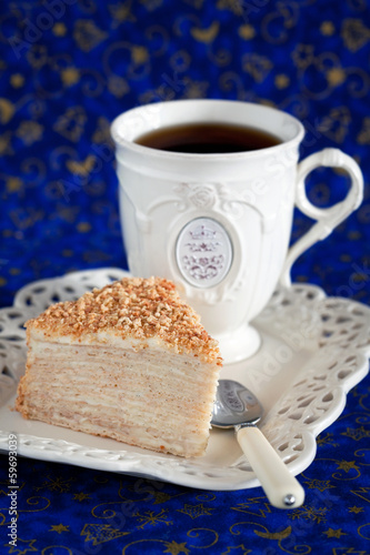 "Slice of layer cake with custard ""Napoleon"", selective focus"