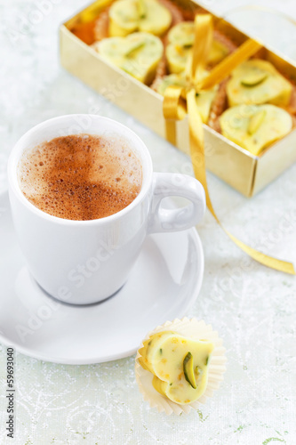 Homemade white chocolate candy heart, cup of hot coffee