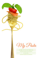 Fork with spaghetti, tomato, salmon and basil isolated
