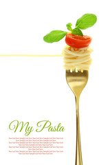 Fork with spaghetti, tomato and basil isolated on white