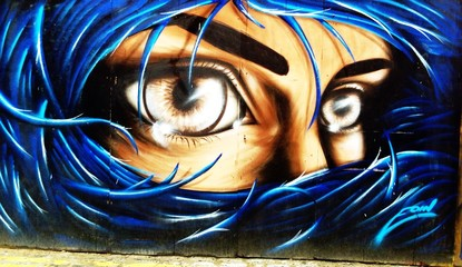 graffiti portrait of a woman with blue hair on Londons streets