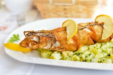 Deep fried pike fish on boiled potato pillow