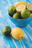 Still life with citrus fruits: limes and lemons