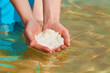 Female hands with sea salt from Dead Sea