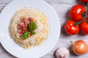Spaghetti with bolognese sauce and ingredients. top view