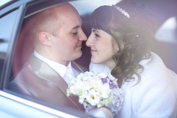 bride and groom in the car