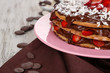 Chocolate cake on wooden table close-up