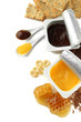 Tasty desserts in open plastic cups and honey combs, isolated