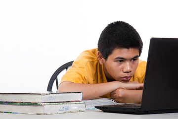 Teenage high school boy studying