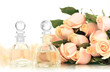 Beautiful bouquet of roses and perfume, isolated on white