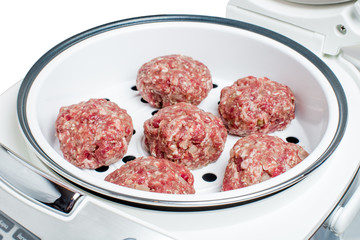 Raw beef cutlets in boiler