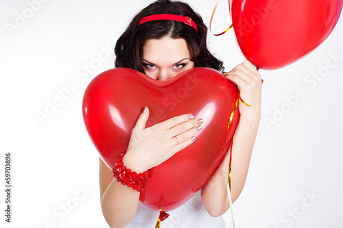 valentine's day beautiful young woman with red balloons