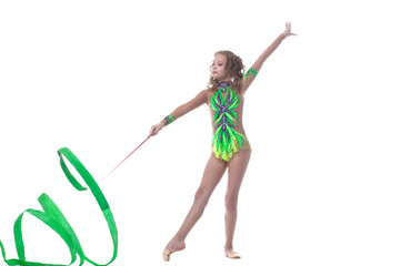 Elegant young gymnast dancing with ribbon