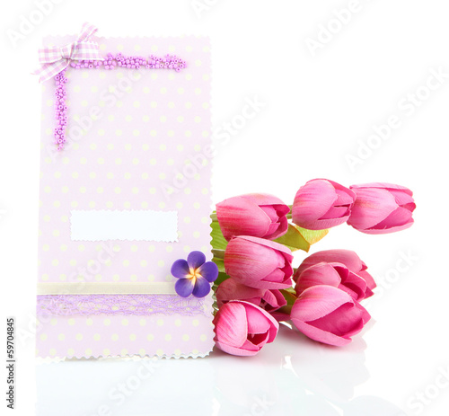 Beautiful hand made post card and flowers, isolated on white