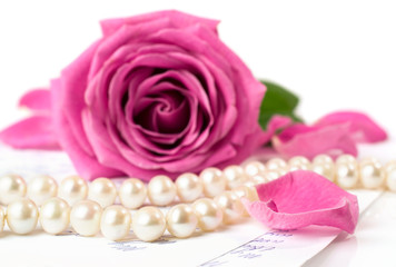String of pearls and a pink rose