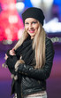 Fashionable lady wearing cap and black jacket outdoor in xmas