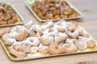 Tray with sugary donuts with pestiños background