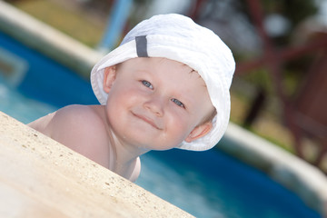 cute toddler by a swimming pool