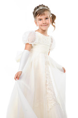 little girl wearing gown dancing isolated on white