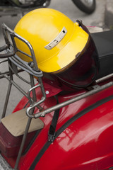 Yellow helmet on red scooter