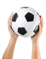 Hands holding soccer ball up