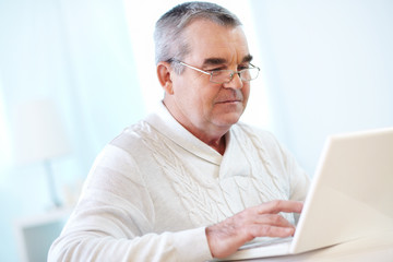 Mature man typing