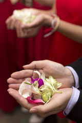 Hand of bridesmaids holding flower