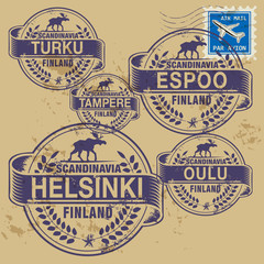 Grunge rubber stamp set with names of Finland cities