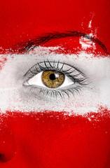 Austria flag painted over female face