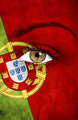 portugal flag painted over female face