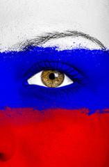 Russia flag painted over female face