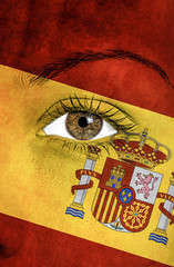 spain flag painted over female face